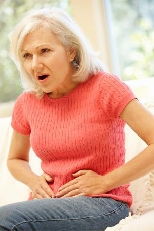 older woman with inguinal hernia