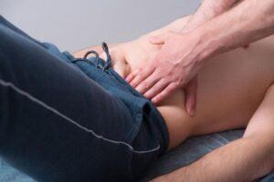 physical exam of inguinal hernia