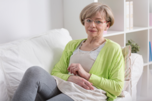 woman resting on couch after gallbladder surgery