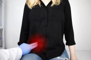 doctor hands examining appendix